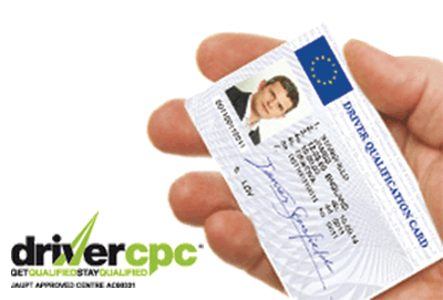 Image shows Driver Qualification Card in a drivers Hand